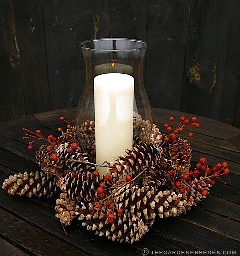 There's such a sweet, timeless feel to this hurricane glass candle holder surrounded by real pine cones and winter berries.