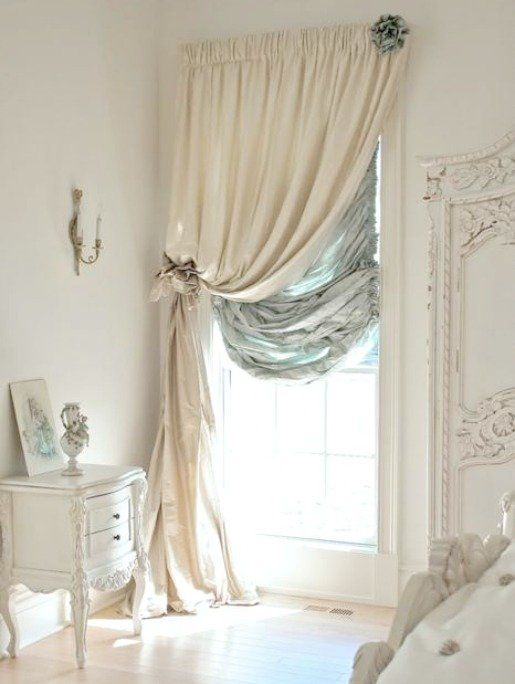 Shabby glam....bedroom dressed in ivory with a touch of turquoise