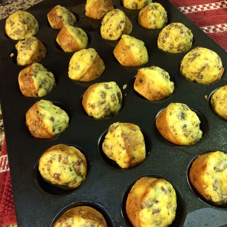 Bite size breakfast casseroles! 1 lb cooked sausage, 5 eggs, 1 cup cheddar cheese, 1 cup Bisquick. Mix all ingredients together, scoop into mini muffin tins and bake 8-10 minutes at 350 degrees. Makes 24-28 mini muffin size casserole bites. Freezer friendly!
