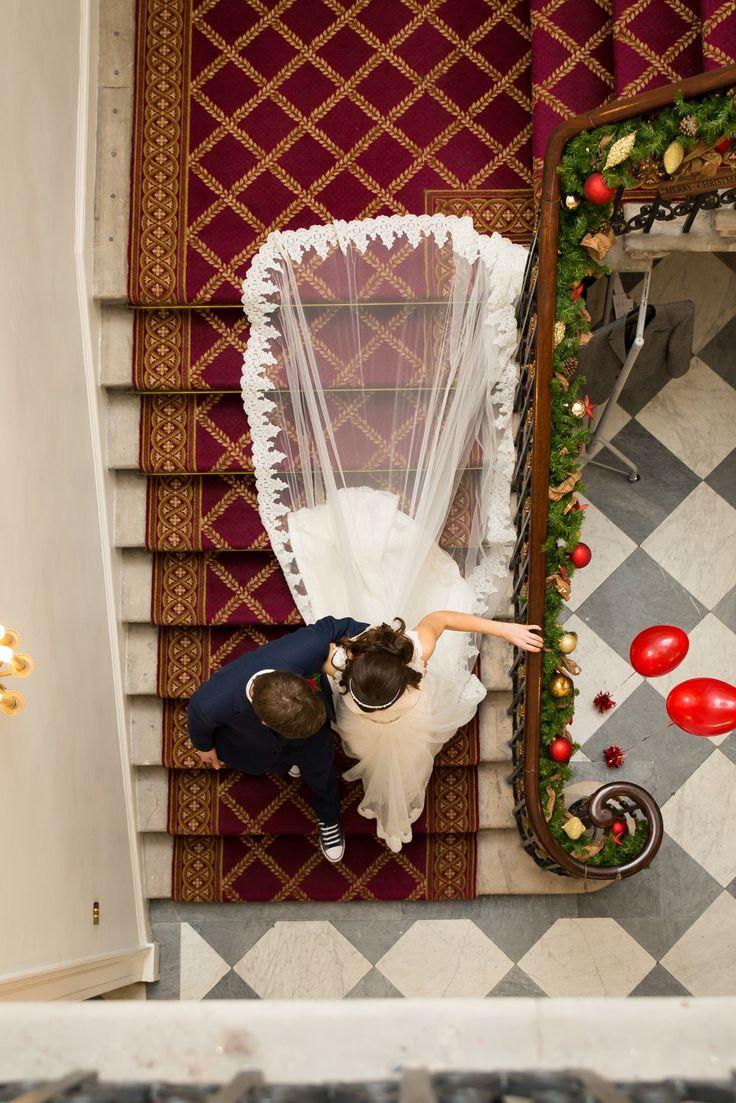 Our Christmas Wedding Chandos House, London. Wedding dress train air shot.