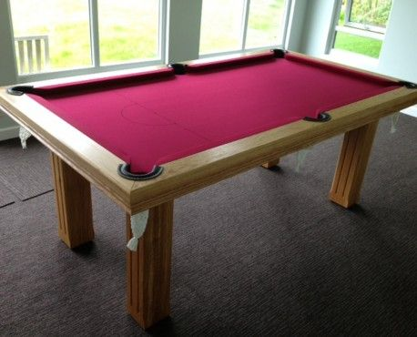 Solid European oak 7' pool table with one piece slate and 4 square fluted legs.  Shop here: http://www.snookerandpooltablecompany.com/pool-tables/uk-pool-tables/modern-bespoke-uk-pool/royal-7-x-4-pool-table-square-fluted-legs.html