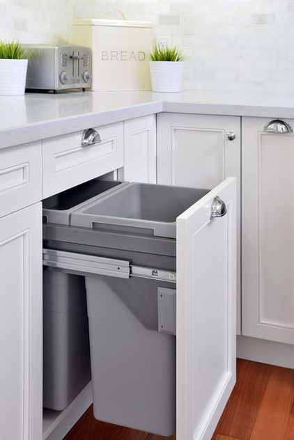 trash/recycling center--nice and deep cans.  drawer comes out with knee bump! Transitional Kitchen by ATD Contracting Services Inc.