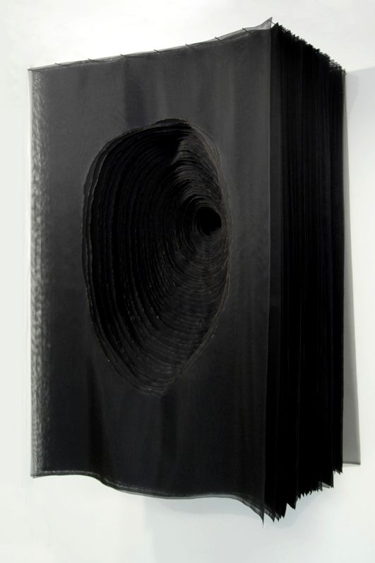 beili liu, void: Each of the 49 layers of silk organza holds a delicate ring drawn with a burning incense. Each ring reduces in size until it recedes to a small circle. Through the void of the layering black silk, the spectator is drawn to a subtle hint of light at the end of the portal.