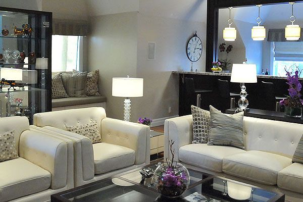Living room space designed by Glen & Jamie from Peloso Alexander Interiors. #sofa #table #design #lamp #shelves