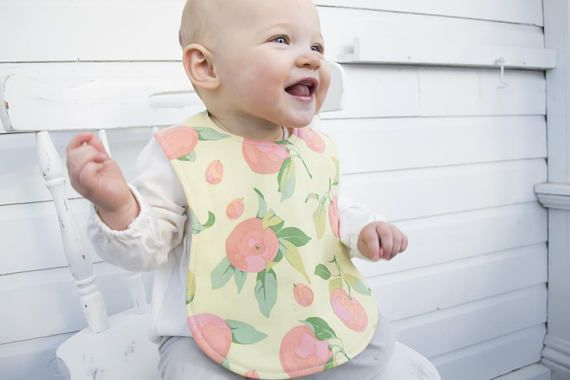 This cute baby bib is waterproof and great for the beginner eater.  Repin to make shopping for your next baby shower quick and easy! #genderneutral #babyshower #babyaccessory
