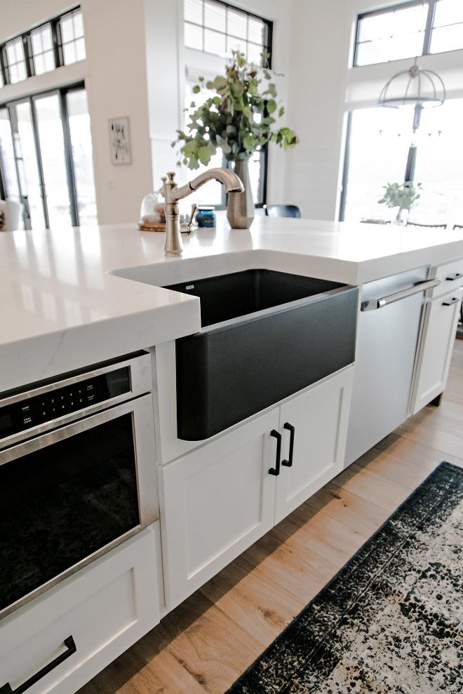 change to white farmhouse sink topped the kitchen off with gorgeous easy to maintain marble look quartz countertops cahnge the babinets to black and