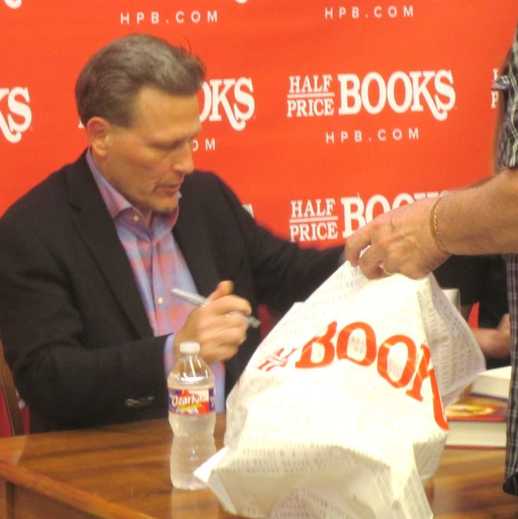 "Thriller author extraordinary David Baldacci dropped by the Dallas HalfPrice Books store. Fortunately, he practices a two-handed signing technique to handle all the autograph requests. I blogged April 21, 2015, with ""David Baldacci at HalfPrice? Really!"