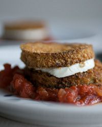 Eggplant and Goat-Cheese | Golden eggplant slices sandwich tangy, melting cheese, all set off by a fast tomato sauce flavored with the unusually complementary tarragon. #howisummer