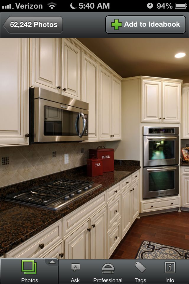 Biscotti with cocoa glaze cabinets and dark brown granite for Granite colors for black cabinets
