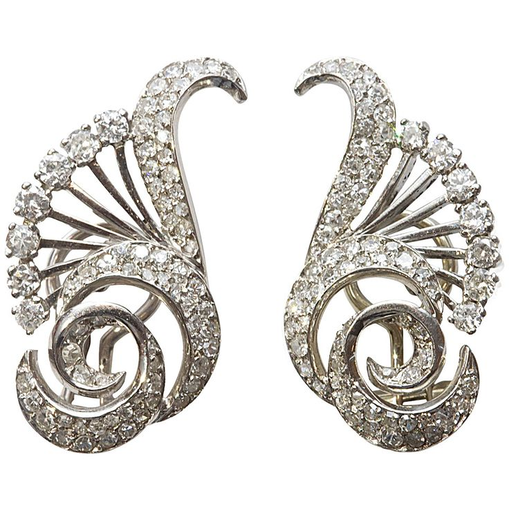 French Art Deco Diamond Platinum Earrings. A good combination of Art Deco style and French craftsmanship. The form is typical of the art deco time period with the differing shapes all coming together to create a symmetrical design. There is approximately 3 carats of white, clean diamonds expertly set in platinum. c 1930s