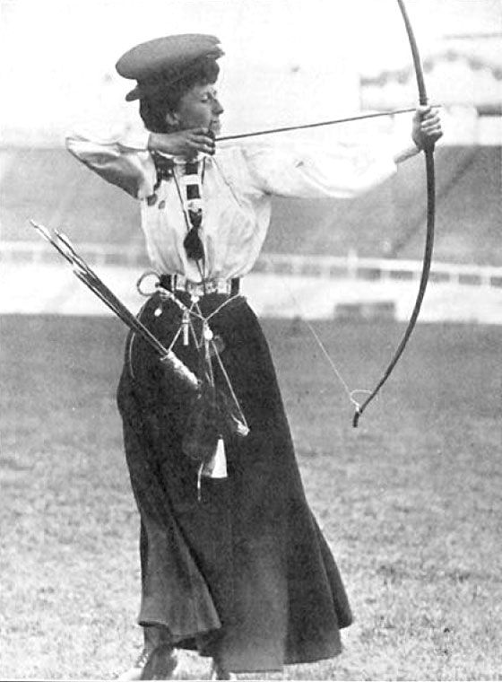 Queenie Newell won an archery gold medal at age 53, then competed for another 20 years. Read more about her on Wikipedia. This photo is in the public domain.