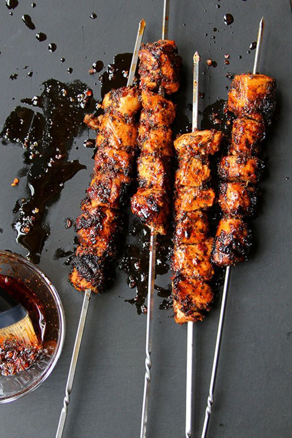 A thick, flavorful marinade of mint, Aleppo pepper, and Turkish sweet red pepper paste caramelizes on the outside of these grilled chicken kebabs.