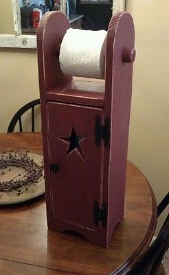 Primitive toilet paper holder/ storage/ home décor.  This would be great as a paper towel sized cabinet!