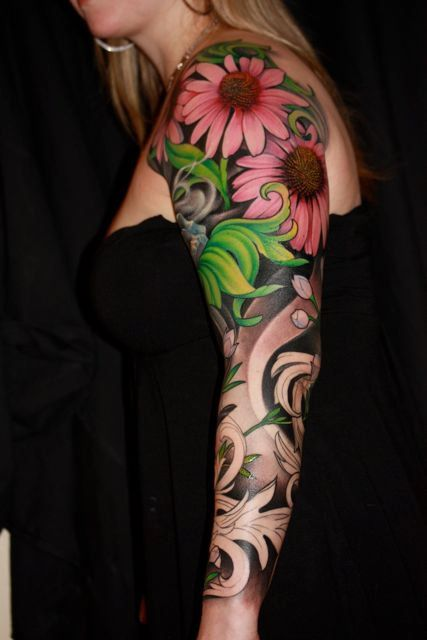 I love the flowers! They're so real looking. Jeff Gogue #tattooing #tattoo #art