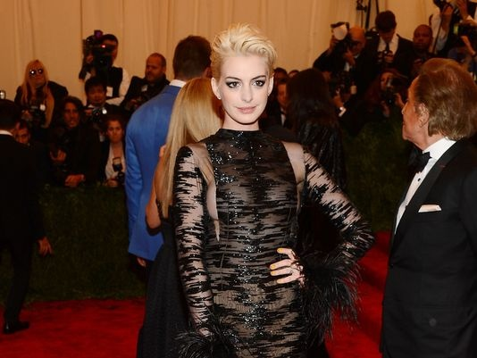 The inspiration behind Anne Hathaway's blonde hairstyle and other celebrity looks from the #Met Gala red carpet. #oribe