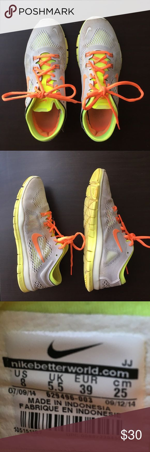 Light Grey & Neon Nike Shoes Light grey/neon/orange Nike Free TR Fit 4. 3 years old but well taken care of. Great for walking, running, or casual wear. Have a lot of life left in them! Nike Shoes Athletic Shoes