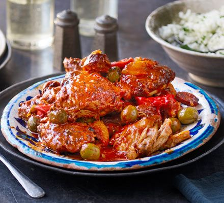 This slow-cooked stew is packed with Mediterranean flavour from chorizo, olives, tomatoes and peppers. The meat will fall off the bone – mop up the sauce with bread