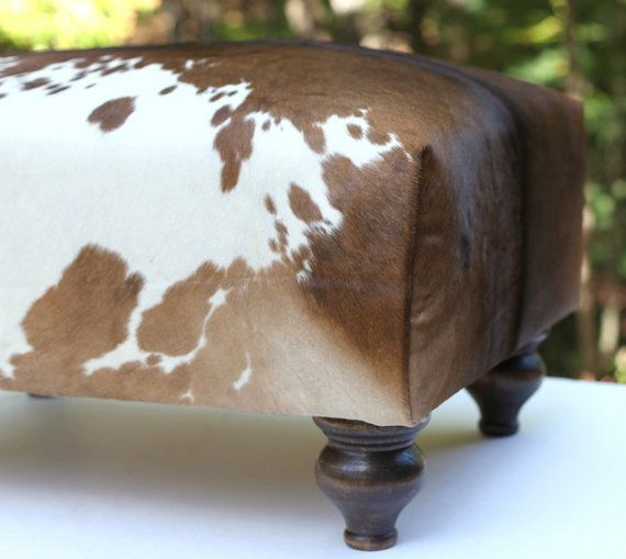 We might need some cowhide. different legs maybe? Handcrafted Cowhide Ottoman - Handmade with New Materials Dark Brown and White Exotic Leather Hide Footstool Stool - Furniture