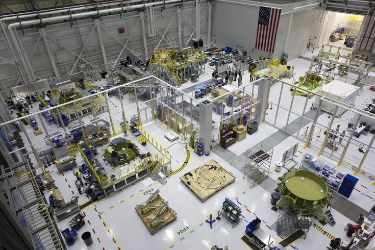 https://flic.kr/p/JgEy7T   KSC-20171030-PH_KLS01_0130   A view from above shows several Boeing CST-100 Starliner spacecraft in various stages of processing in the high bay inside the company's Commercial Crew and Cargo Processing Facility at NASA's Kennedy Space Center in Florida. The Starliner will launch astronauts on a United Launch Alliance Atlas V rocket to the International Space Station as part of NASA's Commercial Crew Program. Photo credit: NASA/Kim Shiflett NASA image use policy.