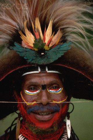 Papuan Tribesman With a Plumed Headdress -- smiling