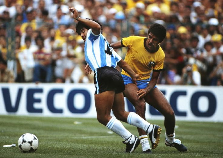 Diego Maradona of Argentina tussles with Brazil at the World Cup. Credit: Colorsport.