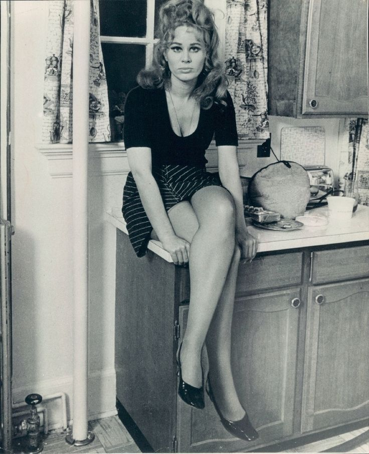 "grapnel: ""Karen Black sitting on a counter-top. """