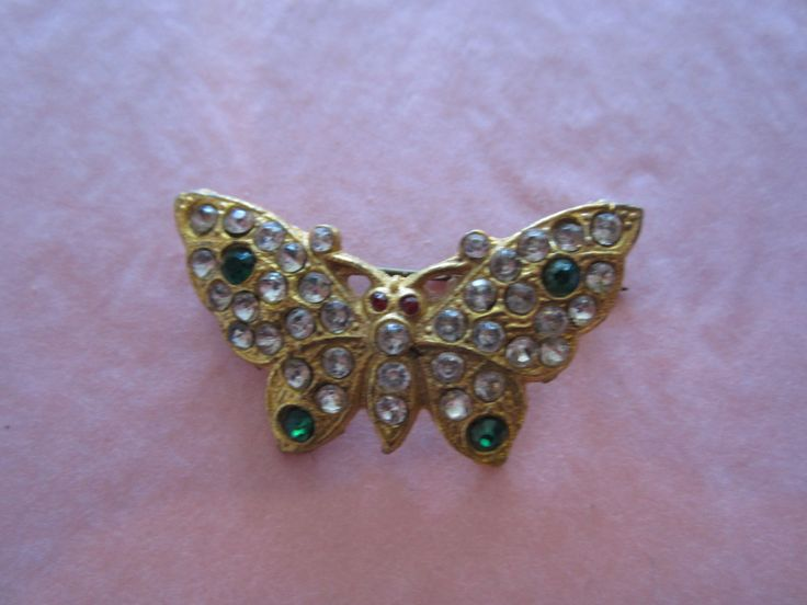 Vintage Rhinestone butterfly broach with green stones