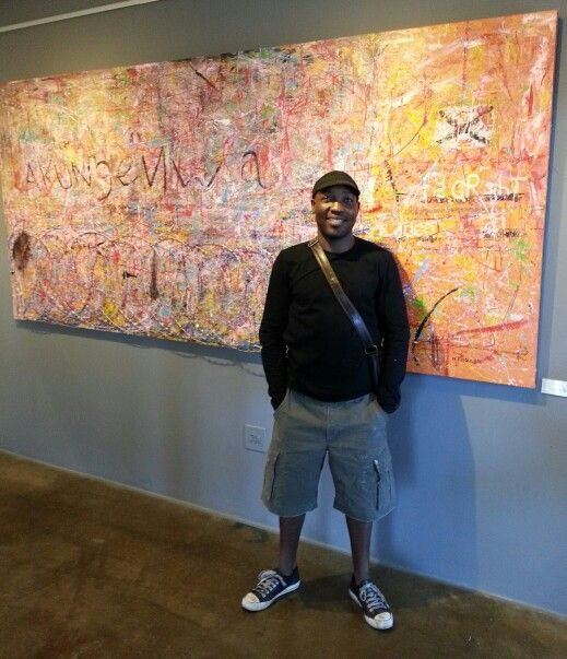 """Thomas stands with his exceptional new work titled """" AKUNGENWA"""""""