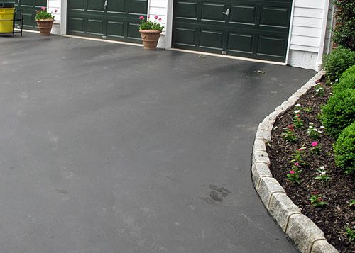 Learn how to provide attractive and functional cobblestone edging to an asphalt driveway.