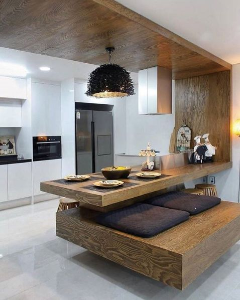 Clever island design, soothing wood tones, what are your thoughts?  West Vancouver - Like, Comment, Share!