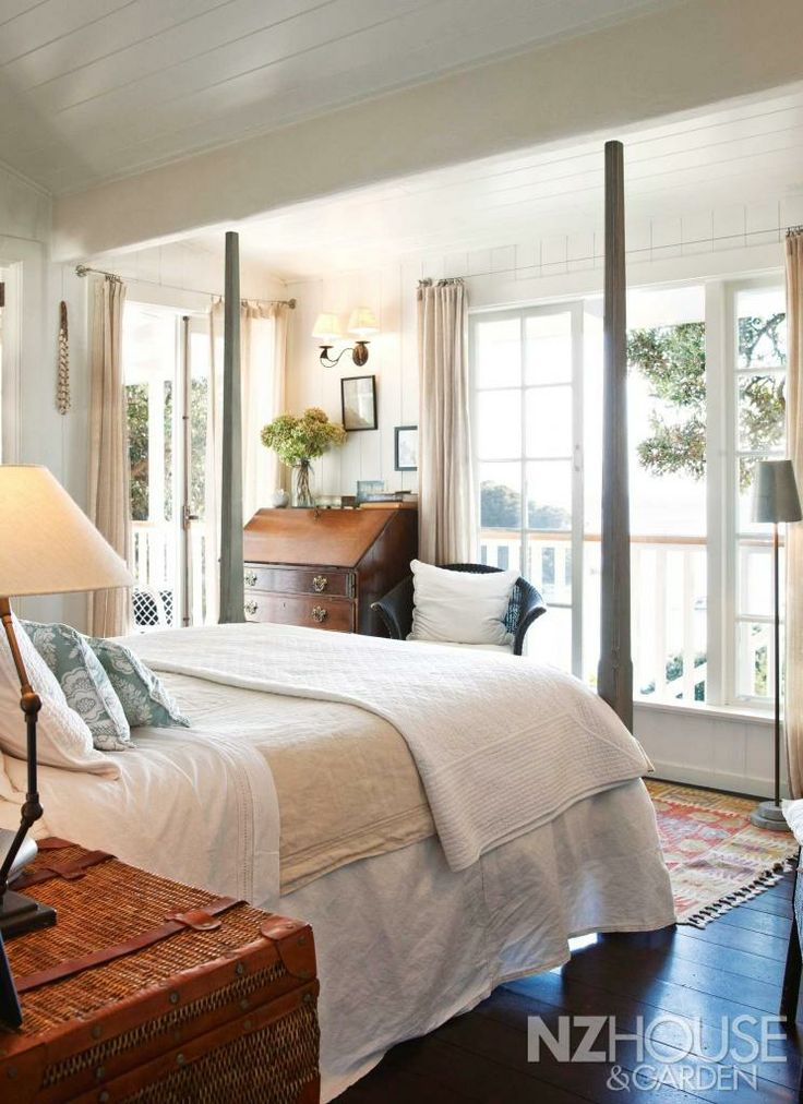 New Zealand cottage bedroom with four poster bed and white