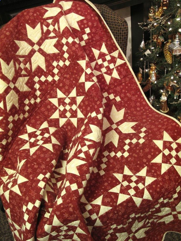 Fair Isle Christmas quilt in red and white at Holly Hill Quilt Shoppe. Made from the brushed cottons of a Holly Taylor collection.