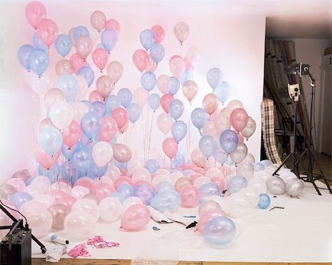 Balloons set (2004)  I was once on a porn set. It wasn't how I had imagined it would be. I was part of a production crew making a documentary about online porn. We were in the upstairs bedroom of a small terraced house in the north of England. Outside all the houses looked the same: red-bricked back-to-backs with cobbled lanes. Quiet streets, half-net curtains hung in windows. In a small bedroom a man who looked like Benny Hill wearing a blonde Beatle wig was directing two young girls in…