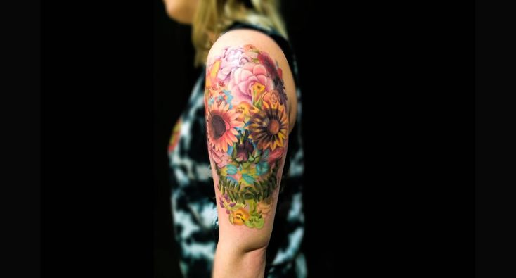 skull flower tattoo on arm