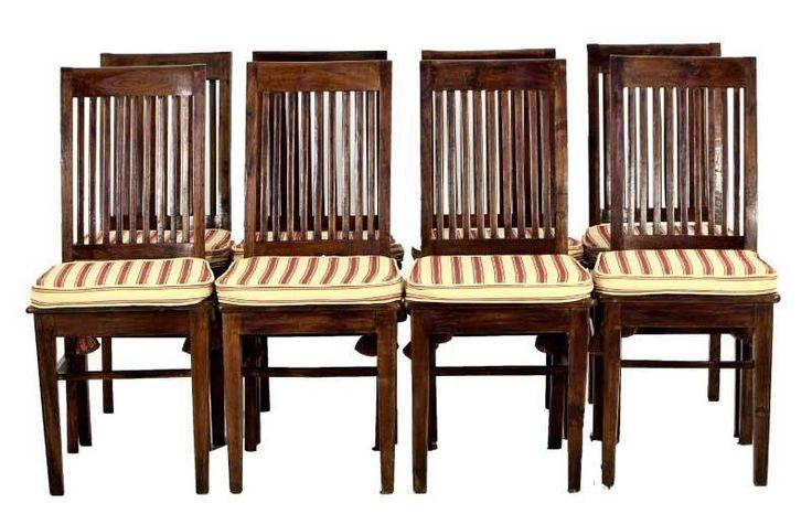 Lote 4330 - Conjunto de 8 cadeiras de costas altas em castanho. Costas de ripas e assentos em madeira com coxins em tecido de riscas. Pés de secção quadrangular unidos por travessas. Dim: 100x44x44 cm. Nota: sinais de uso, falhas e defeitos. - Current price: €140