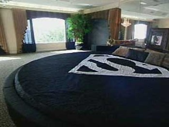 Shaq O'Neals Giant Round Superman Bed, want that size but minus the superman logo