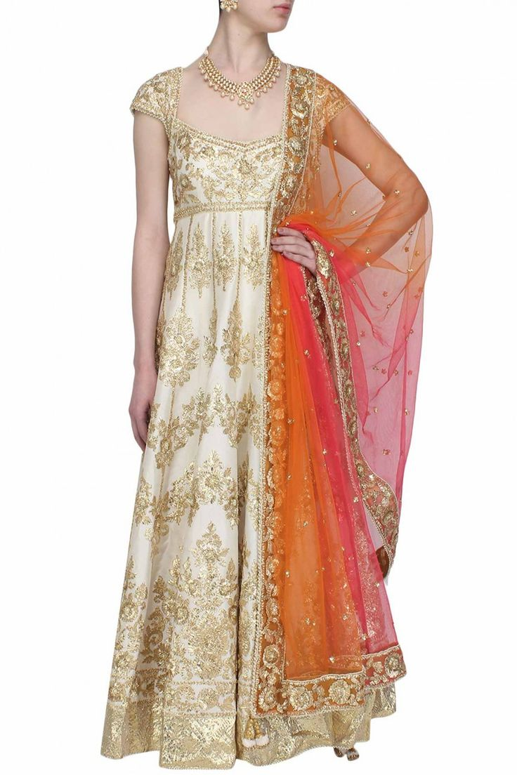 This offwhite anarkali is made in raw silk base appliqued with floral pattern…