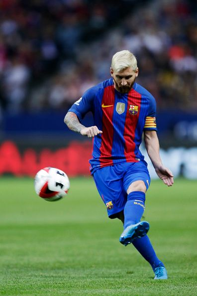 Lionel Messi of FC Barcelona shoots a free kick during the International Champions Cup match between Leicester City FC and FC Barcelona at Friends...