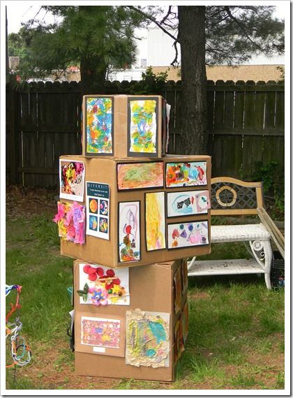 Use cardboard boxes to display your kids' artwork