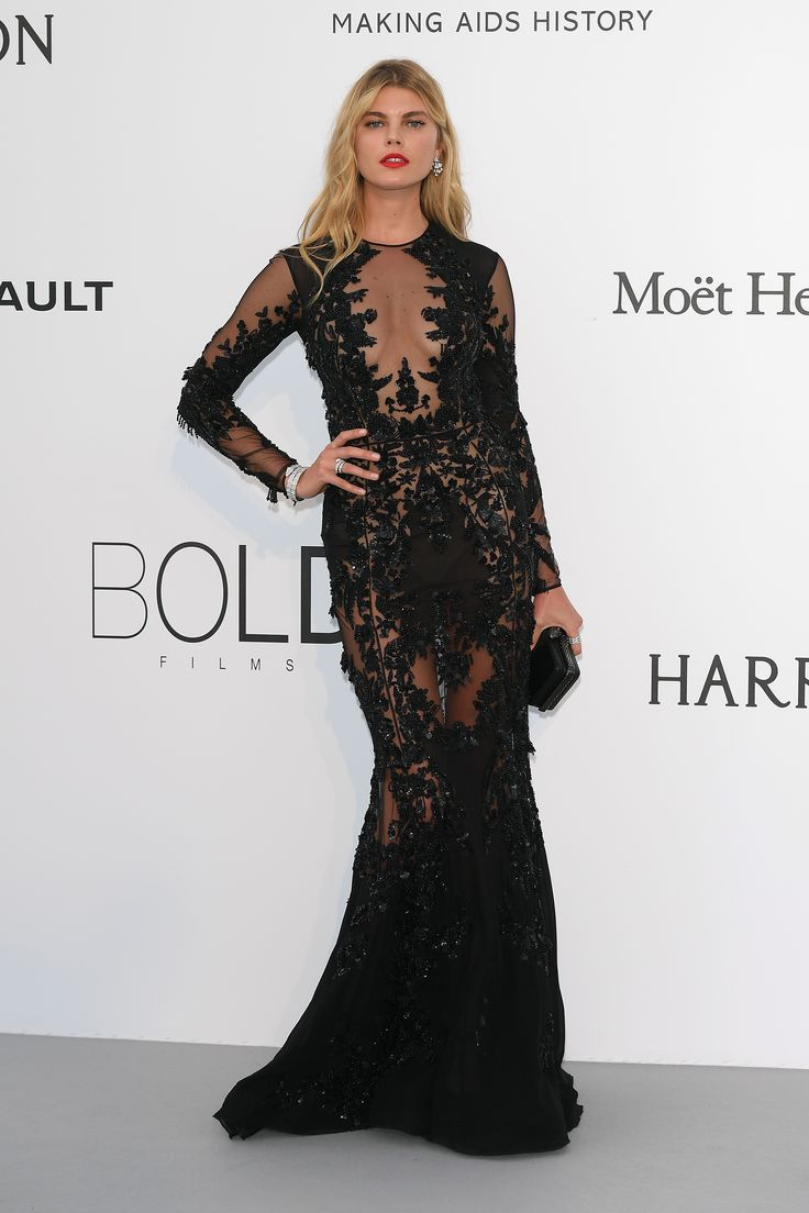 Model Maryna Linchuck wore Bulgari Serpenti bracelet, earrings and rings in white gold and diamonds, and high jewellery diamond earrings with her black lace long sleeve floor length dress, with mesh detailing and loose blonde curls. At the amFAR Gala. For glamour celebrity fashion Cannes Film Festival red carpet jewellery spotting travel here: http://www.thejewelleryeditor.com/jewellery/top-5/cannes-film-festival-amfar-gala-2017-red-carpet-jewellery/ #jewelry