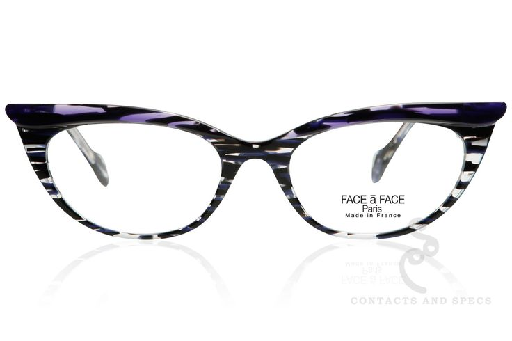 Face-a-Face Eyewear style Ebony 1. This sultry cat-eye, is a dramatic acetate frame with soft curves and translucent coloring. Channeling the lovely ladies from Mad Men, these specs are anything but o