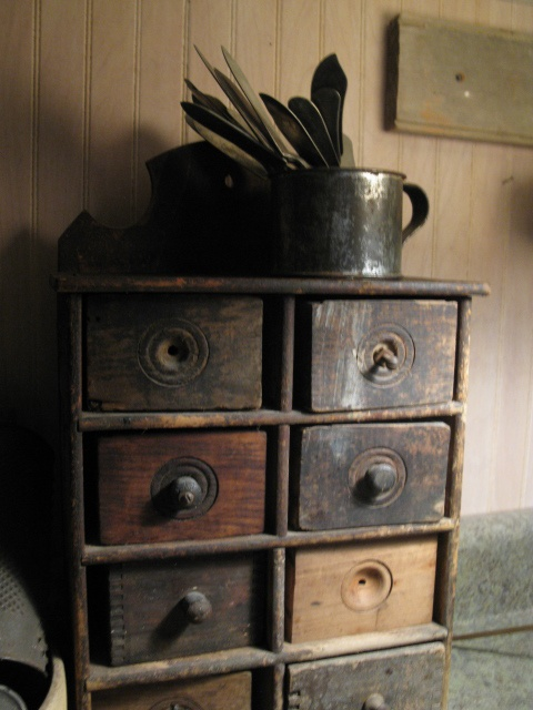 My favorite apothecary. Old, drawers don't match. Pulls, if there, don't match. Does it get any better? HighButtonShoe farmhouse.