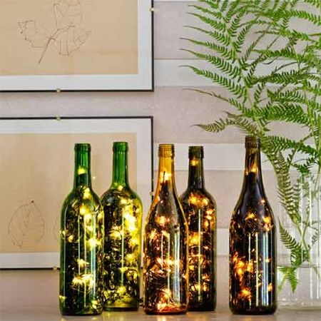 Fairy string lights in wine bottle (use led lights to keep them from getting overly hot)