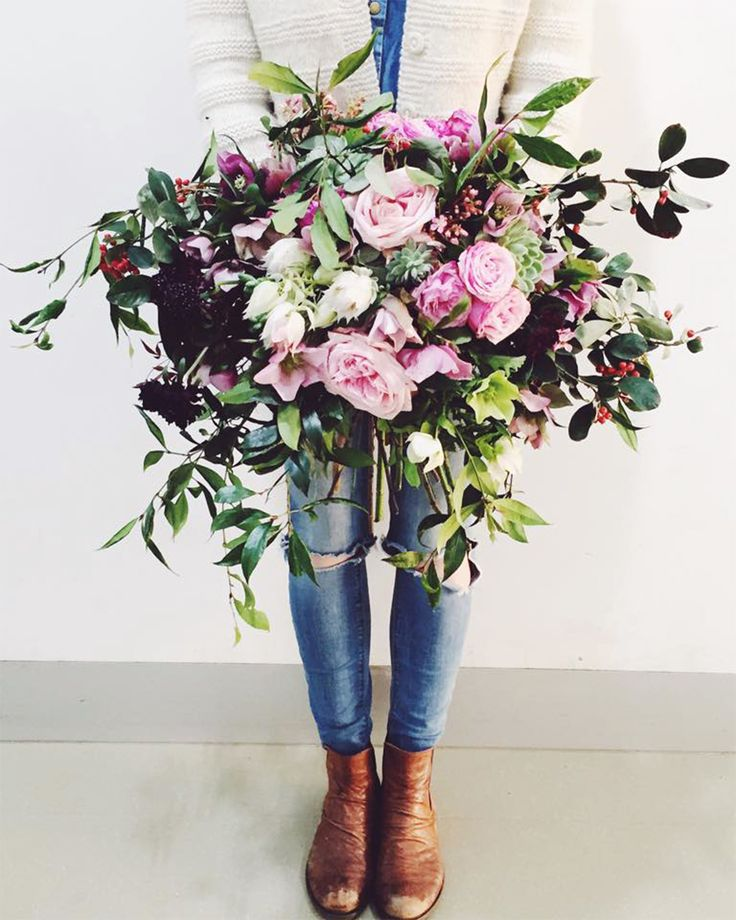 wild and unstructured bouquet of roses and foliage