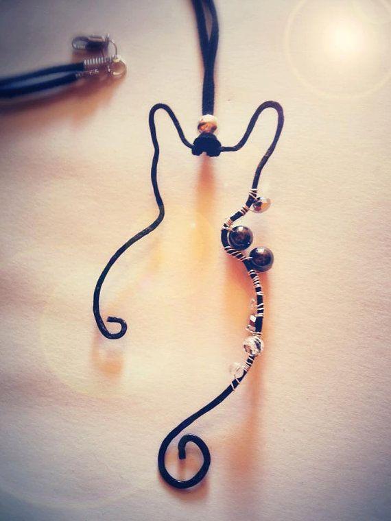 black wire beaded cathematite swaroskpendant by EmeraldsDreams, $18.00