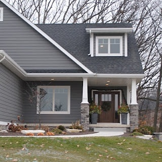 dark gray siding w brown door and white trim
