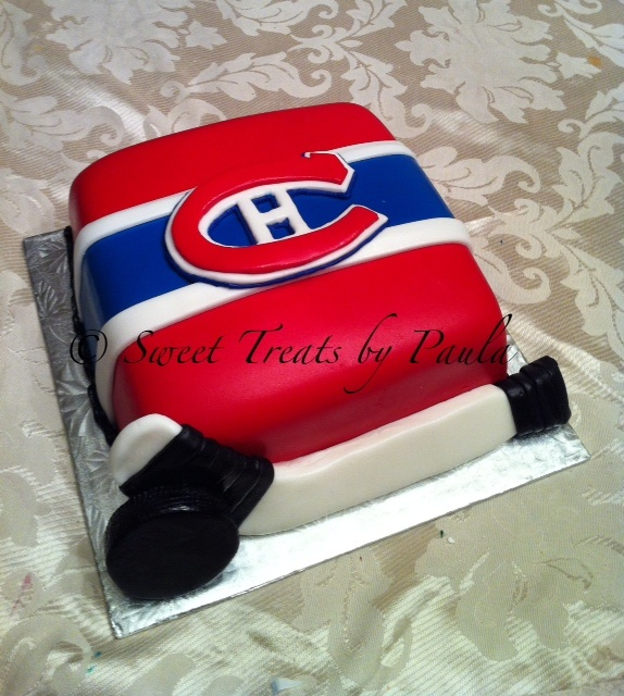 hockey cake! @Valerie Bryant-Guzik, would look much better in red & green, dont ya think?
