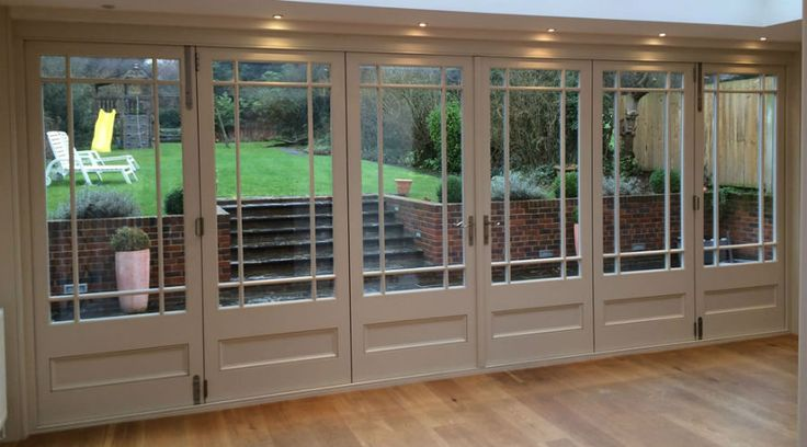 wood fording doors with overlooking a gardens