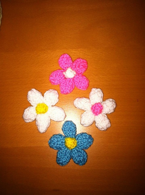 3.  Favorite summer knitting pattern:  Made about 50 of these this summer.  Every little girl I run into gets one (or two :)     Ravelry: wesben's Daisy hair accessory