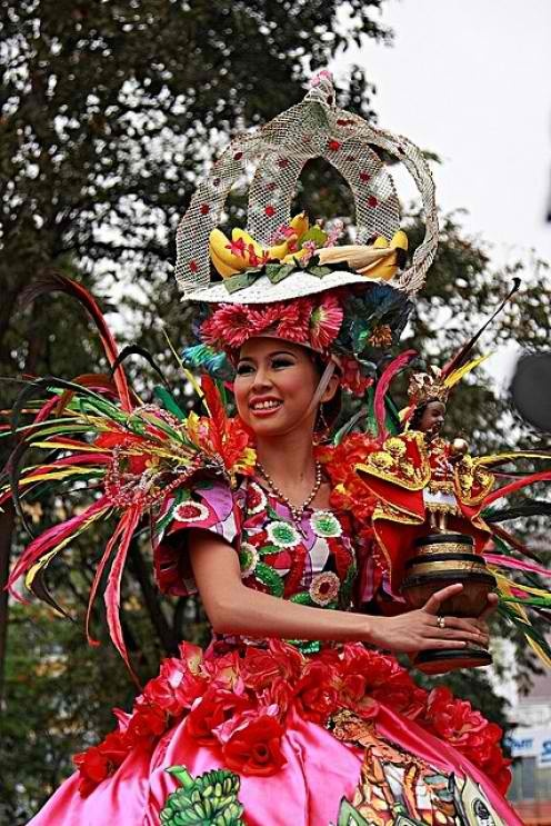 Filipina girl in her best attire on a street dancing during Philippine festival